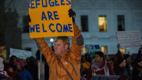 Una manifestazione pro rifugiati in America - Sputnik Italia