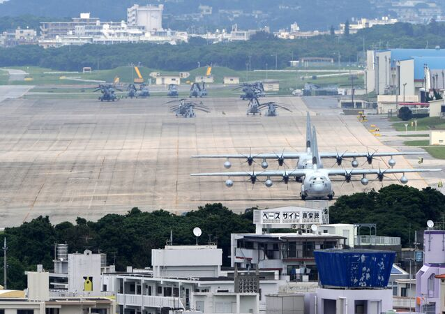 (FILES) A file picture taken on April 24, 2010 shows planes and helicopters stationed at the US Marine Corps Air Station Futenma base in Ginowan, Okinawa prefecture