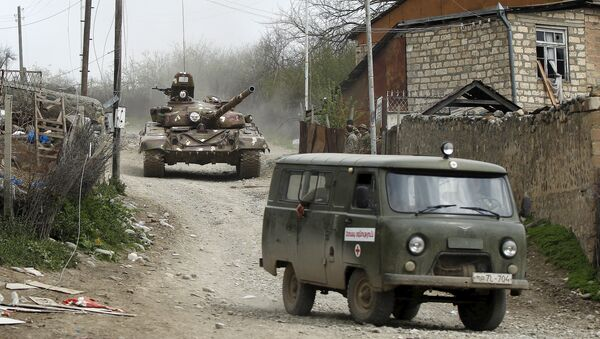 A tank of the self-defense army of Nagorno-Karabakh moves on the road in the village of Talish April 6, 2016 - Sputnik Italia