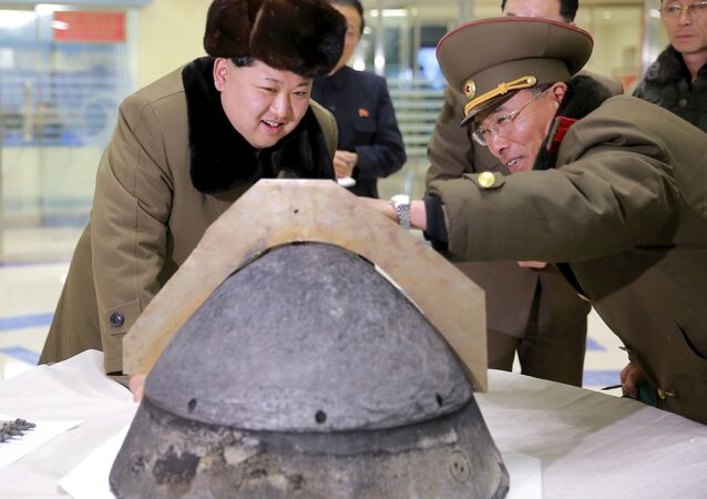 North Korean leader Kim Jong Un looks at a rocket warhead tip after a simulated test of atmospheric re-entry of a ballistic missile, at an unidentified location in this undated file photo released by North Korea's Korean Central News Agency (KCNA) in Pyongyang on March 15, 2016.