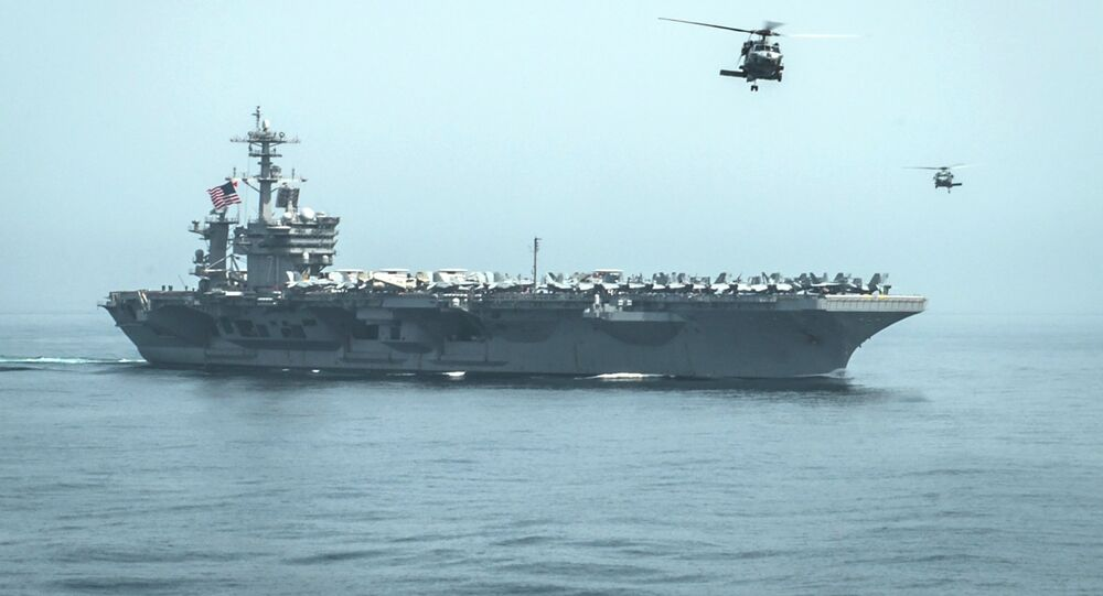 Helicopters fly from the aircraft carrier USS Theodore Roosevelt (CVN 71) during a resupply mission with the aircraft carrier USS Carl Vinson (CVN 70) in this U.S. Navy handout picture taken in the Gulf of Oman April 13, 2015 and released April 20, 2015