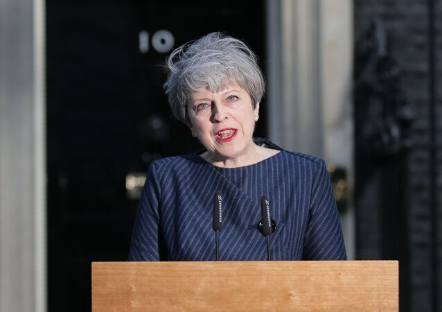 British Prime Minister Theresa May speaks to the media outside 10 Downing Street in central London on April 18, 2017.