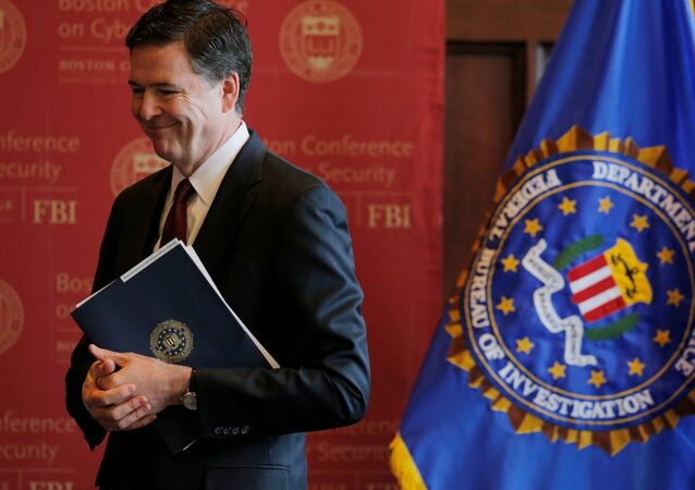 FBI Director James Comey listens as he is thanked for speaking at the Boston Conference on Cyber Security at Boston College in Boston, Massachusetts, US, March 8, 2017.