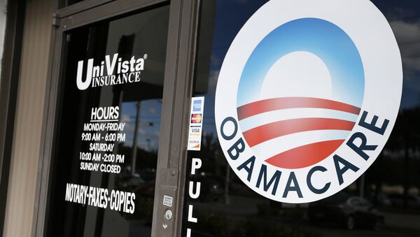 An Obamacare logo is shown on the door of the UniVista Insurance agency in Miami, Florida on January 10, 2017 - Sputnik Italia