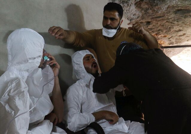 A man breathes through an oxygen mask as another one receives treatments, after what rescue workers described as a suspected gas attack in the town of Khan Sheikhoun in Idlib, Syria April 4, 2017