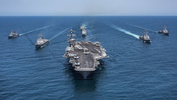In this image released by the U.S. Navy, the aircraft carrier USS Carl Vinson, flanked by South Korean destroyers, from left, Yang Manchun and Sejong the Great, and the U.S.Navy's Wayne E. Meyer and USS Michael Murphy, transit the western Pacific Ocean Wednesday, May 3, 2017. - Sputnik Italia