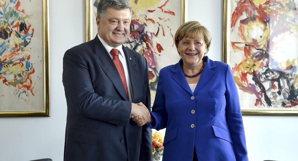 Petr Poroshenko e Angela Merkel