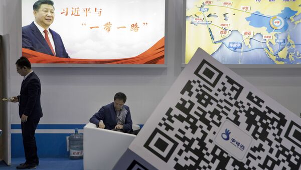Visitors at a technology conference wait near illuminated boards highlighting Chinese President Xi Jinping's signature One Belt, One Road foreign policy plan in Beijing, China, Friday, April 28, 2017 - Sputnik Italia