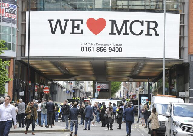 Police evacuate the Arndale shopping centre, in Manchester, England Tuesday May 23, 2017