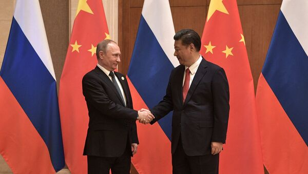 President Vladimir Putin and President of China Xi Jinping, right, during the Russia-China talks at the One Belt, One Road international forum - Sputnik Italia