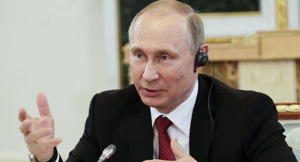 Russian President Vladimir Putin speaks during a meeting with representatives of international news agencies in St. Petersburg, Russia, June 1, 2017.