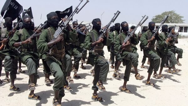 In this Thursday, Feb. 17, 2011 file photo, hundreds of newly trained al-Shabab fighters perform military exercises in the Lafofe area some 18 km south of Mogadishu, in Somalia - Sputnik Italia