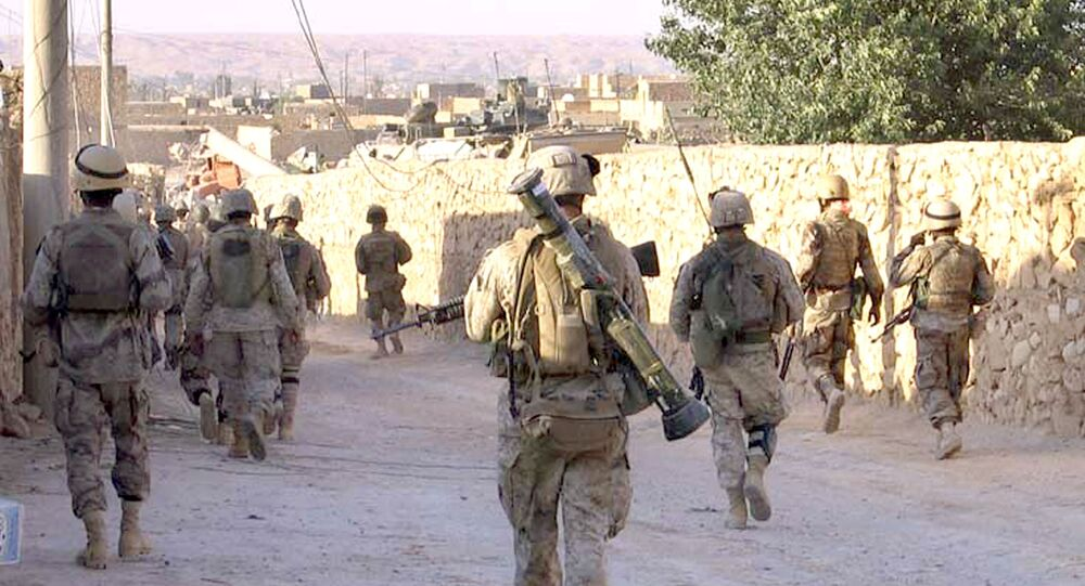 A picture released by the US Marines shows Marines from 3rd Battalion, 2nd Marine Regiment (3/2) and Iraqi Special Forces patrolling a street in the city of Karabilah, near Iraq's northwestern border with Syria (file)