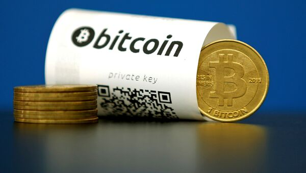 A Bitcoin (virtual currency) paper wallet with QR codes and a coin are seen in an illustration picture taken at La Maison du Bitcoin in Paris, France May 27, 2015 - Sputnik Italia