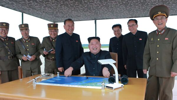 North Korean leader Kim Jong Un inspects a long and medium-range ballistic rocket launch drill in this undated photo released by North Korea's Korean Central News Agency (KCNA) in Pyongyang on August 30, 2017 - Sputnik Italia