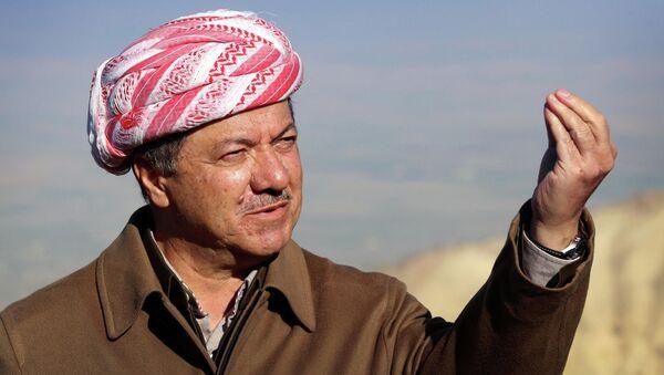 Iraqi Kurdish leader Masoud Barzani speaks to journalists on December 21, 2014 during a visit to Mount Sinjar, west of the northern Iraqi city of Mosul. - Sputnik Italia