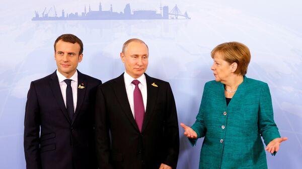 Macron, Putin e Merkel (foto d'archivio) - Sputnik Italia