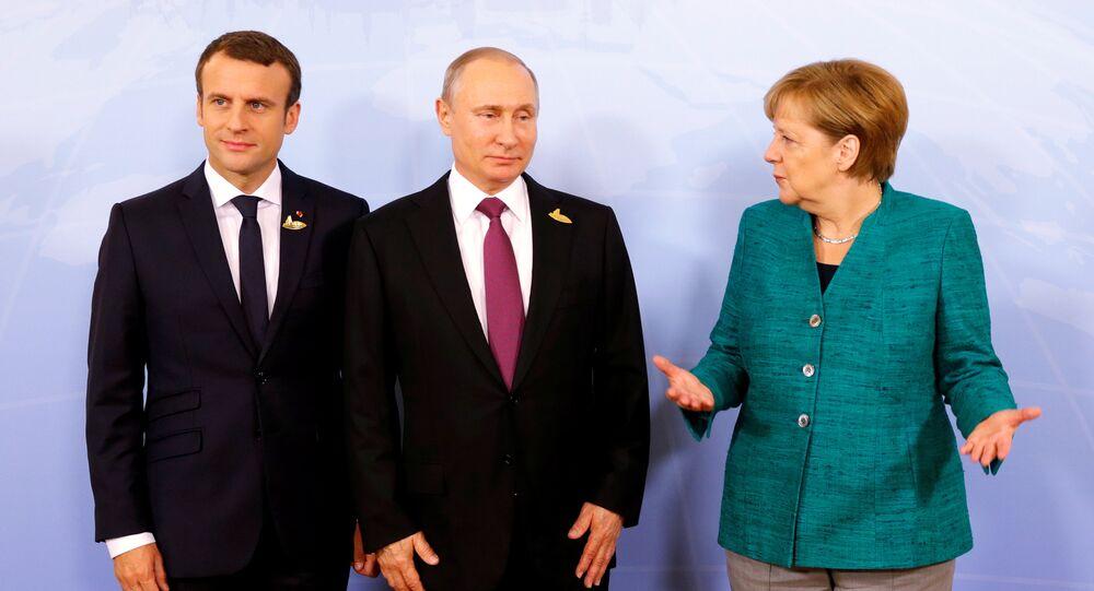 Macron, Putin e Merkel (foto d'archivio)