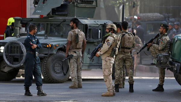 Afghan security forces leave after gunfire at the site of an attack in Kabul, Afghanistan July 31, 2017 - Sputnik Italia