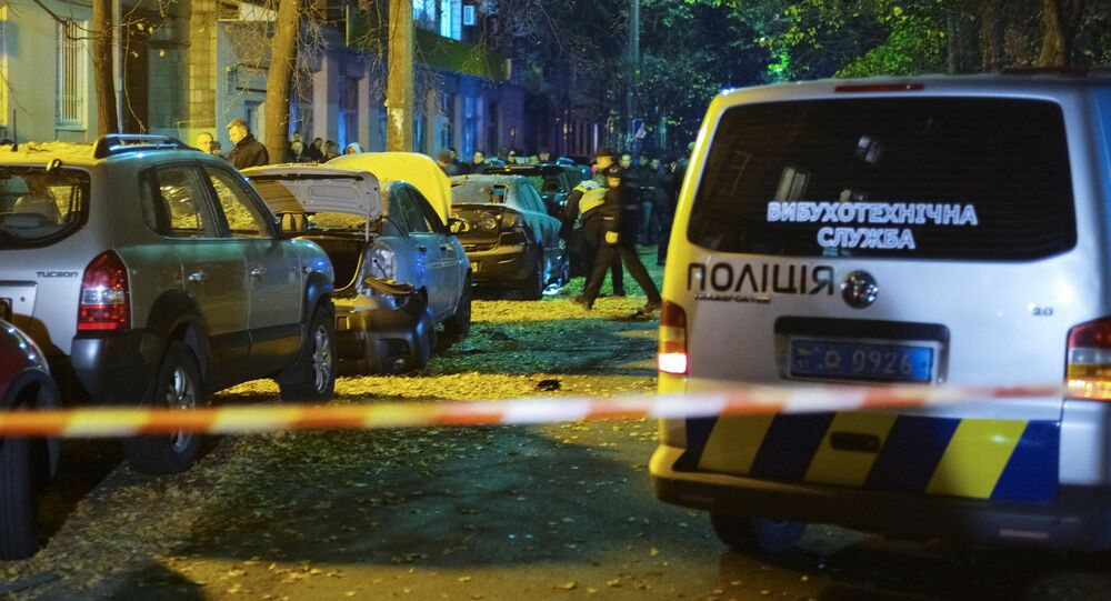 Investigators work at the site of a car explosion in central Kiev, Ukraine October 25, 2017.