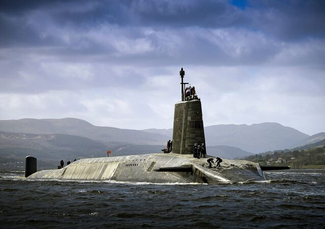 Royal Navy Vanguard Class submarine HMS Vigilant returning to HMNB Clyde after her extended deployment.