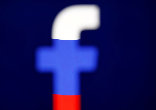 A 3D-printed Facebook logo is displayed in front of the Russian flag, in this illustration taken October 25, 2017.