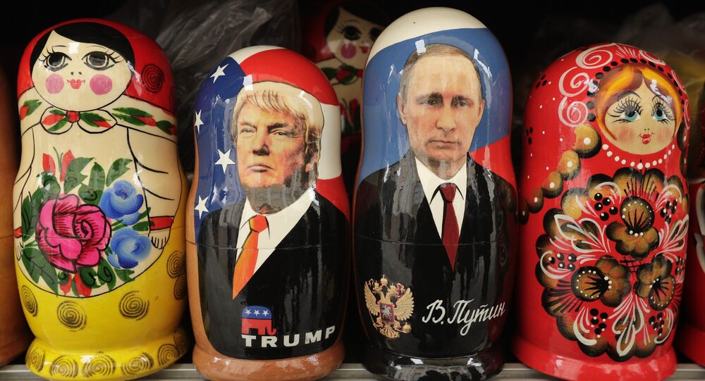 In this Monday, Feb. 20, 2017 traditional Russian wooden dolls called Matryoshka depicting US President Donald Trump, centre left and Russian President Vladimir Putin are displayed for sale at a souvenir street shop in St.Petersburg, Russia