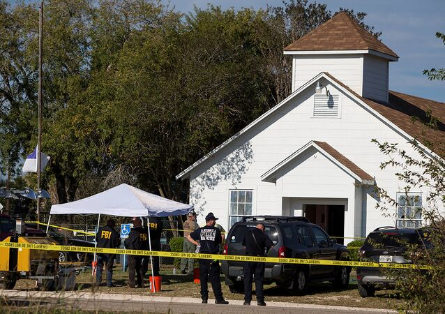Law enforcement officials investigate a mass shooting at the First Baptist Church in Sutherland Springs, Texas, U.S. November 5, 2017