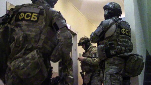 Agenti dell'FSB impegnati in un blitz - Sputnik Italia