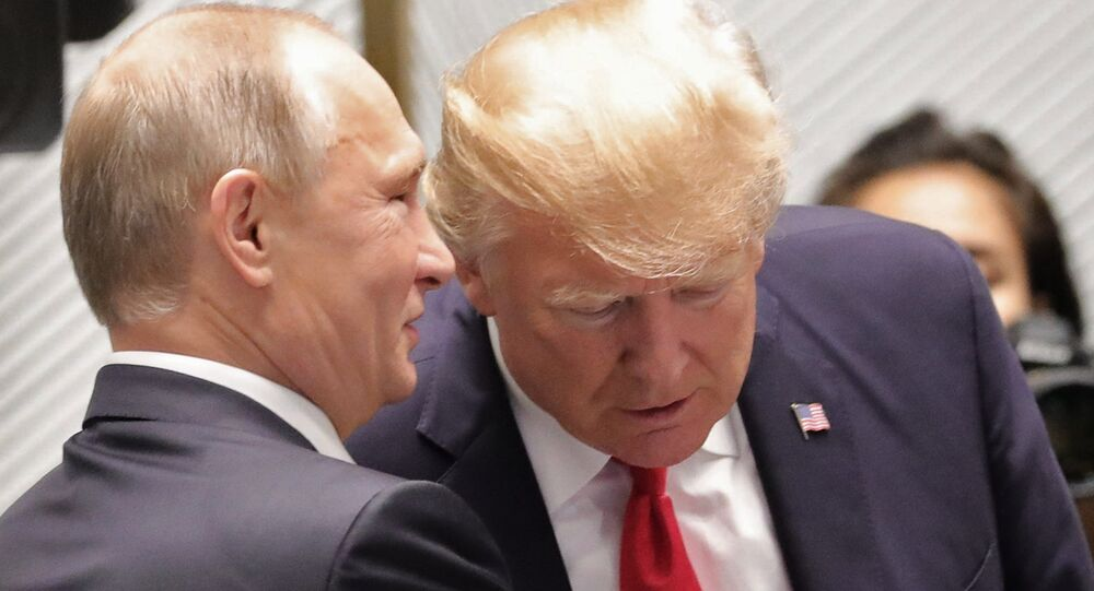 Russian President Vladimir Putin and US President Donald Trump, right, are seen here ahead of the first working meeting of the Asia-Pacific Economic Cooperation leaders