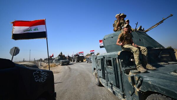 Members of Iraqi federal forces gather to continue to advance in military vehicles in Kirkuk, Iraq October 16, 2017 - Sputnik Italia