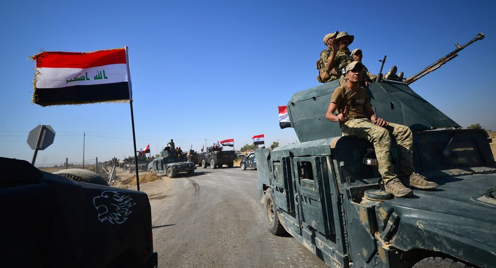 Members of Iraqi federal forces gather to continue to advance in military vehicles in Kirkuk, Iraq October 16, 2017