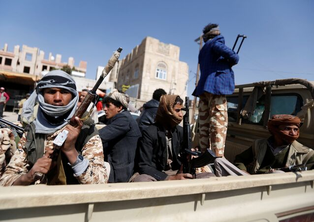 Houthi fighters ride on the back of a truck as clashes with forces loyal to Yemen's former president Ali Abdullah Saleh continue in Sanaa, Yemen