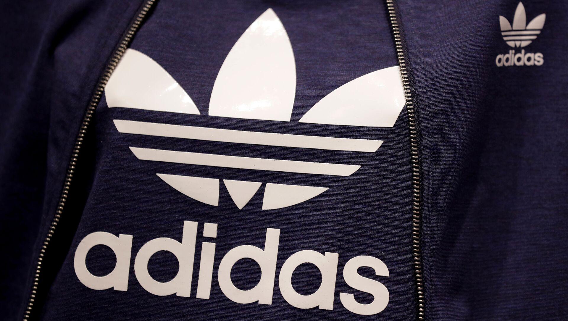 El logo de la marca Adidas - Sputnik Italia, 1920, 07.03.2021