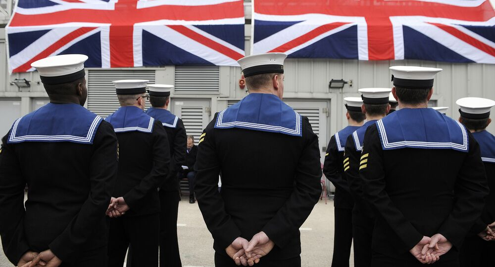 Submariners stand to attention during a ceremony to officially make 'Artful' a commissioned warship of the Royal Navy at Faslane Naval Base, Rhu, Scotland on March 18, 2016.