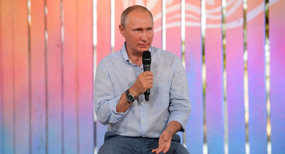 Russian President Vladimir Putin speaks to the organizers and participants of the annual Tavrida National Youth Educational Forum at Bakalskaya Spit in Crimea