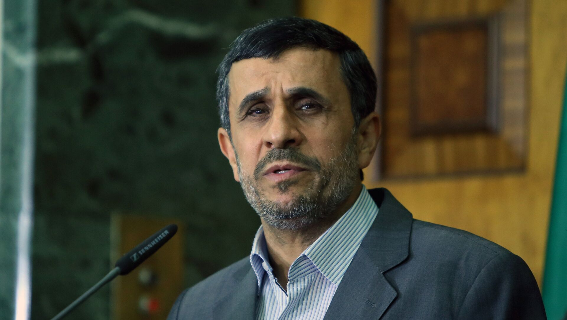 This file photo taken on July 18, 2013 shows Iran's then outgoing President Mahmoud Ahmadinejad speaking during a press conference at the presidential palace in Baghdad. - Sputnik Italia, 1920, 12.05.2021