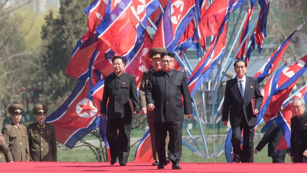 DPRK leader Kim Jong-il, center, at a ceremony to open a new residential area on Ryomyong Street in Pyongyang. - Sputnik Italia