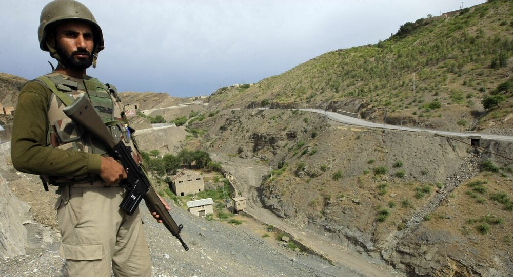 A Pakistan army soldier stands guard in the Pakistani tribal area of Khyber near the Torkham border post between Pakistan and Afghanistan, Wednesday, June 15, 2016.