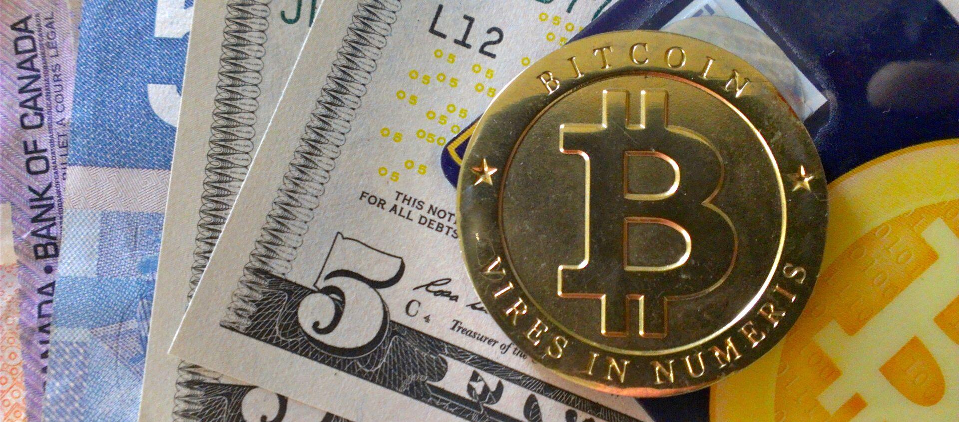 Bitcoin e altri soldi - Sputnik Italia, 1920, 05.03.2021