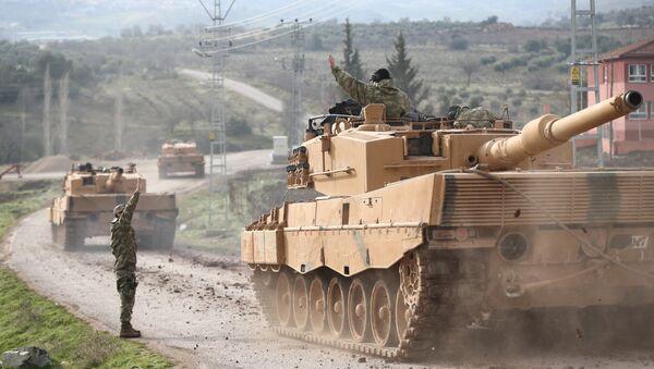 A Turkish military convoy arrives at a village on the Turkish-Syrian border in Kilis province, Turkey, January 21, 2018 - Sputnik Italia