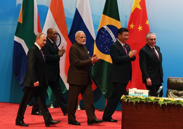 From left: Russian President Vladimir Putin, South African republic President jacob Zuma, Indian Prime Minister Narendra Modi, Chinese President Xi Jinping and Brazilian President Michel Temer seen at the BRICS leaders' meeting with BRICS Business Council members, September 4, 2017