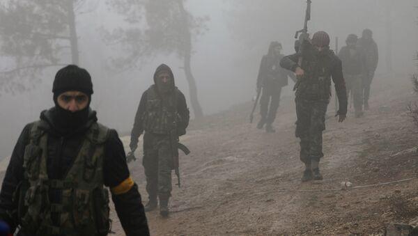 Turkish-backed Free Syrian Army fighters are seen near Mount Barsaya, northeast of Afrin, Syria January 23, 2018 - Sputnik Italia
