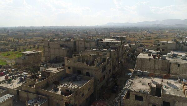 A humanitarian corridor between Damascus and East Ghouta near the Al Wafidin refugee camp in Syria - Sputnik Italia