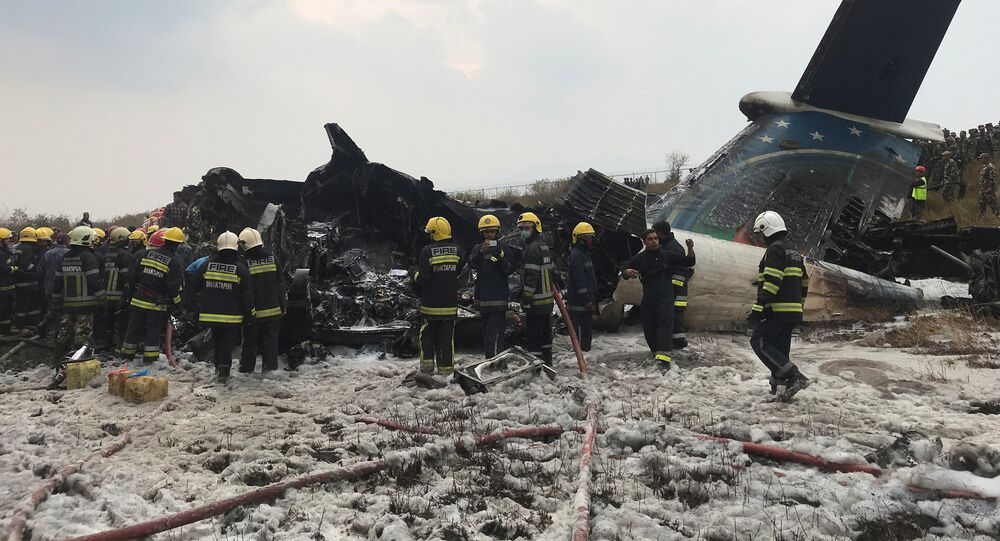 Wreckage of an airplane is pictured as rescue workers operate at Kathmandu airport, Nepal March 12, 2018