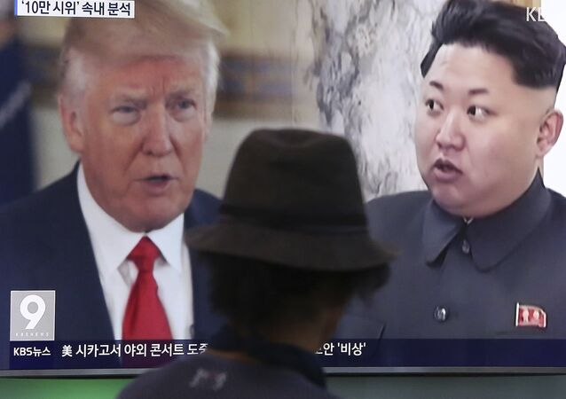 In this Aug. 10, 2017, file photo, a man watches a television screen showing U.S. President Donald Trump and North Korean leader Kim Jong-un during a news program at the Seoul Train Station in Seoul, South Korea.
