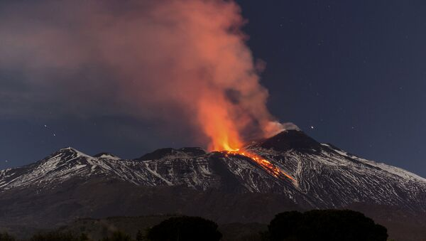 Snow-covered Mount Etna, Europe's most active volcano, spews lava during an eruption in the early hours of Tuesday, April 11, 2017 - Sputnik Italia