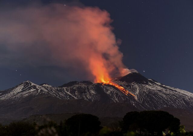 Snow-covered Mount Etna, Europe's most active volcano, spews lava during an eruption in the early hours of Tuesday, April 11, 2017
