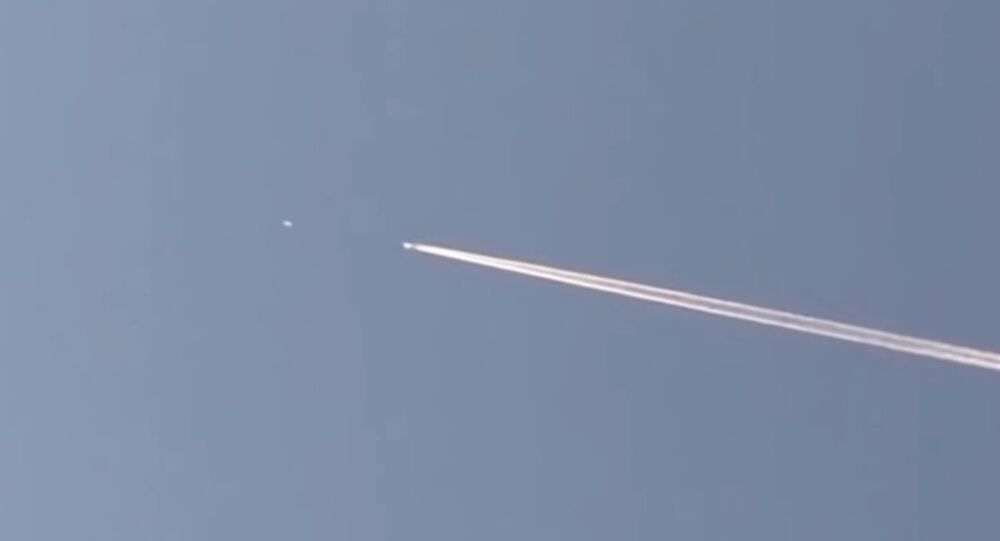 UFO Chases Passenger Jet Through The Sky As Baffled Witness Captures Video