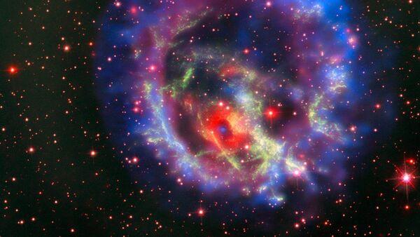 I residui della supernova 1E 0102.2-7219 situata nella Piccola Nube di Magellano, la galassia a noi più vicina. - Sputnik Italia